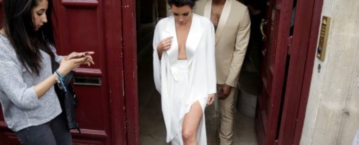 FILE: American reality TV star Kim Kardashian (L) and American singer Kanye West. Picture: AFP.