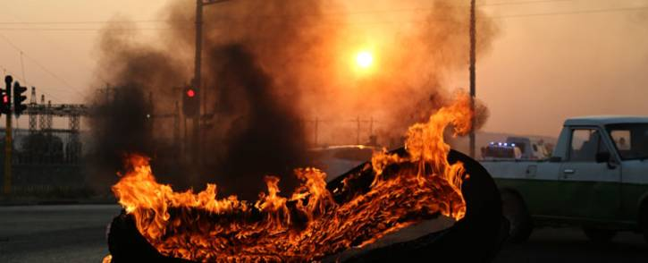 FILE: A tyre burns during a protest in Ennerdale, south of Johannesburg. Picture: Christa Eybers/EWN.