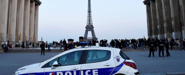 Policemen stand near a vehicle on the place du Trocadero in Paris. Picture: AFP.