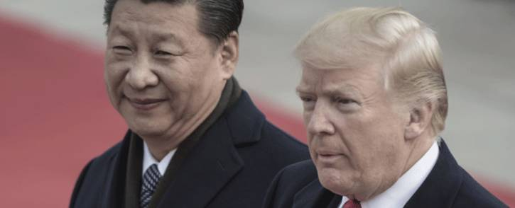 FILE: China's President Xi Jinping and US President Donald Trump attend a welcome ceremony at the Great Hall of the People in Beijing on 9 November 2017. Picture: AFP.