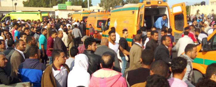 Egyptians gather around ambulances following a gun and bombing attack on the Rawda mosque near the North Sinai provincial capital of El-Arish on 24 November 2017. Picture: AFP