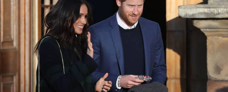 FILE: Britain's Prince Harry (R) and his fiancée US actress Meghan Markle leave a reception for young people in the Palace of Holyroodhouse in Edinburgh, during their visit to Scotland on 13 February, 2018. Picture: AFP