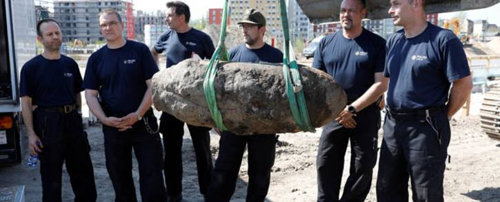 German policemen pose next to a bomb dropped during World War II during the disposal operation on 20 April 2018 in Berlin. Picture: AFP
