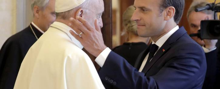 French President Emmanuel Macron (R) greets Pope Francis at the end of a private audience at the Vatican on 26 June 2018. Picture: AFP