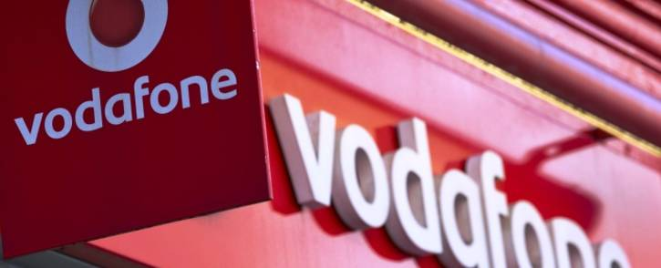 Vodafone signage seen outside a store in central London on 4 September, 2013. Picture: AFP.