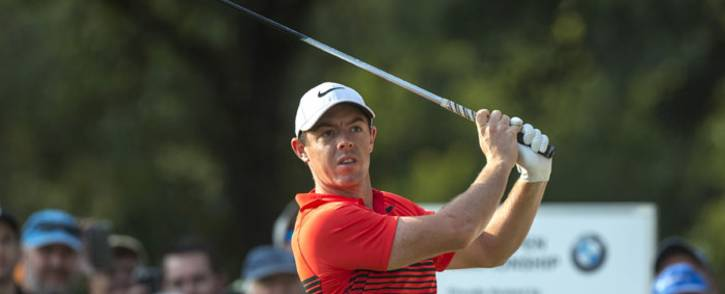 Rory McIlroy keeps an eye on his shot. Picture: AFP