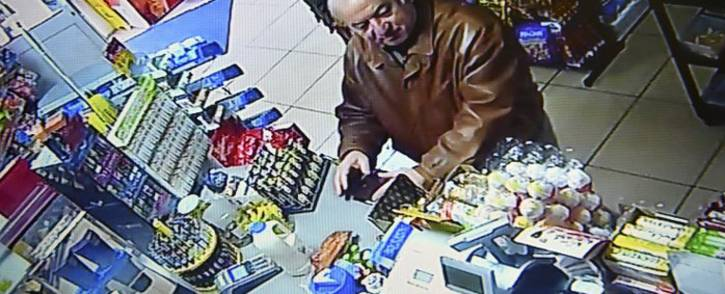 A still image from CCTV footage recorded on February 27, 2018 shows former Russian spy Sergei Skripal buying groceries at the Bargain Stop convenience store in Salisbury on February 27, 2018. Picture: AFP.