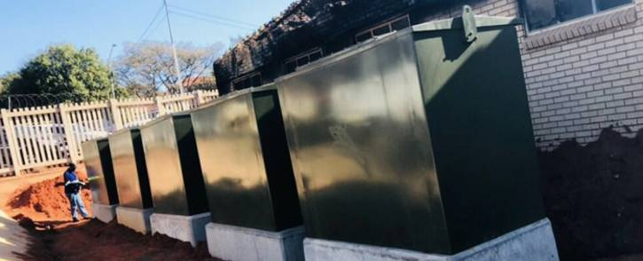 A worker is seen at the damaged Wapadrand substation. Picture: @CityTshwane/Twitter.