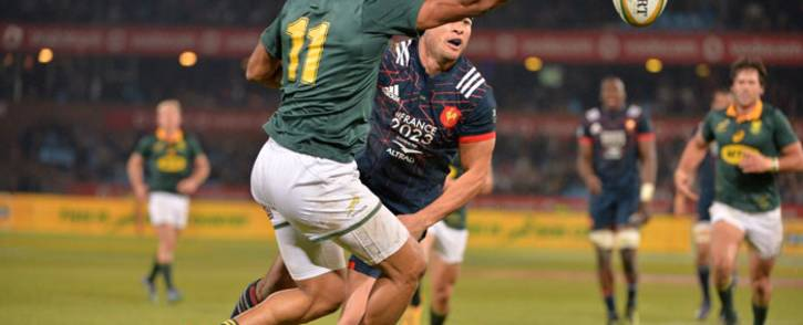 Springbok winger Courtnall Skosan is impeded by a French player during the first Test at Loftus Versfeld. Picture: @Springboks/Twitter