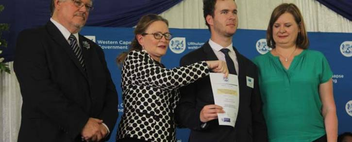 (From left) Head of Department Brian Schreuder, Western Cape Premier Helen Zille, Swartland High learner Pieter Jans Durr and MEC for Education Debbie Schafer at the annual national senior certificate awards ceremony. Picture: Kaylynn Palm/EWN.