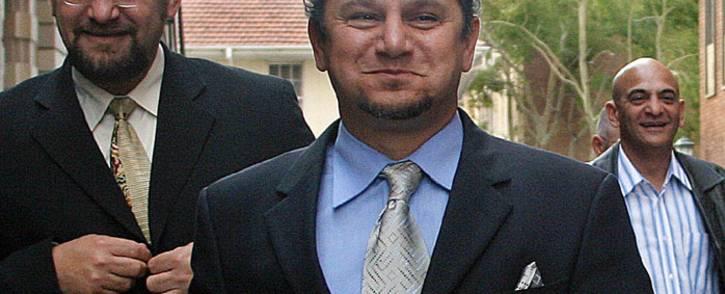 Businessman Schabir Shaik (C) leaves the Durban High court on 26 July 2005. Picture: AFP