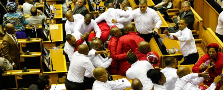 Security officials remove EFF members from the National Assembly after they disrupted President Zuma's 2017 State of the Nation Address. Picture: AFP.