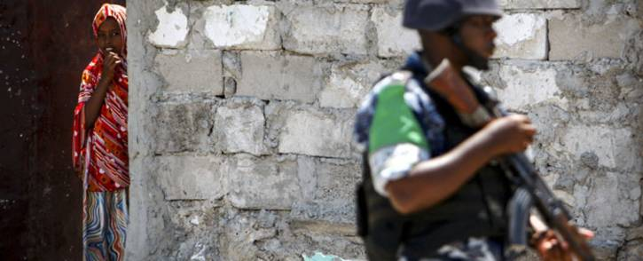 A Ugandan police officer serving with AMISOM patrolling in the Kaa'ran district of the Somali capital, Mogadishu. Picture: United Nations Photo.