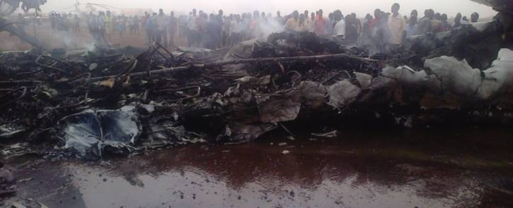 People gather near a plane wreckage after a jet crash-landed in South Sudan's northwestern city of Wau. Picture: AFP