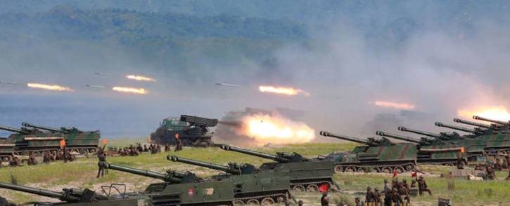 FILE: Rockets being launched by Korean People's Army (KPA) personnel during a target strike exercise at an undisclosed location in North Korea. Picture: AFP