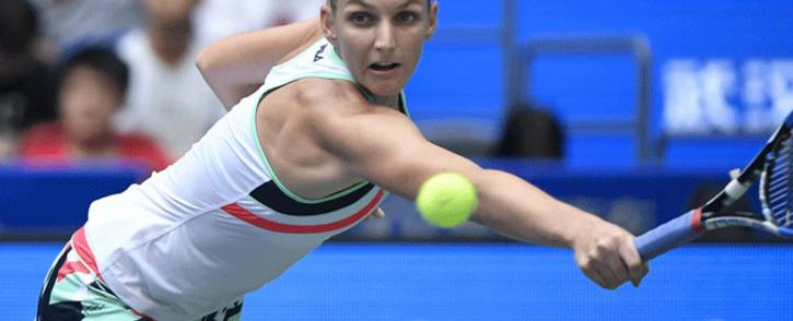 Karolina Pliskova of the Czech Repubic hits a return against Ashleigh Barty of Australia during their women's singles quarter-final match at the WTA Wuhan Open tennis tournament in Wuhan, in China's central Hubei province on 28 September 2017. Picture: AFP.