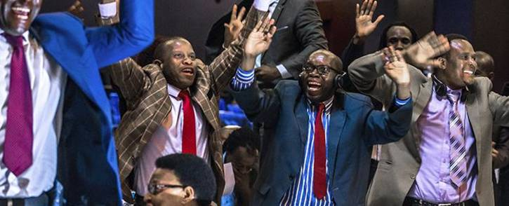 FILE: Zimbabwe's members of parliament celebrate after Mugabe's resignation on 21 November 2017 in Harare. Picture: Jekesai Njikizana/AFP