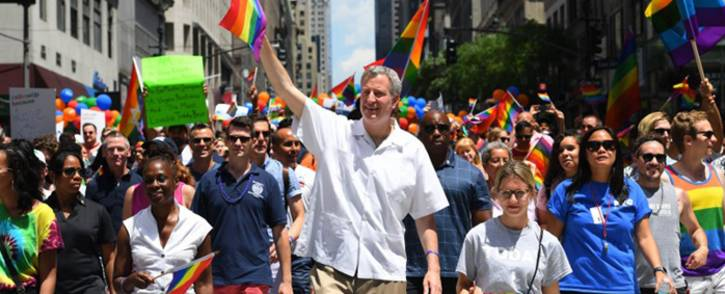 New York City Mayor Bill De Blasio walks alongside parade-goers as they make their way down 5th Avenue during the NYC Pride March on 25 June, 2017. The NYC Pride March celebrates its 48th annual parade. Picture: AFP.