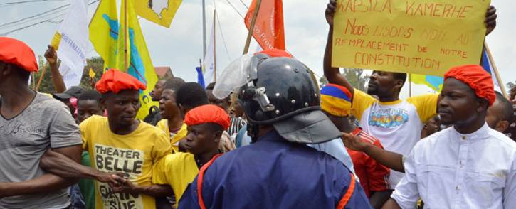 FILE: Hundreds of people hold placards and protest against the government of Democratic Republic of Congo's President Joseph Kabila. Picture: AFP.