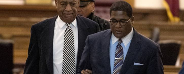 Actor Bill Cosby (left) is escorted outside Montgomery County Courtroom during a pretrial hearing in his sexual assault trial on 3 April 2017 in Norristown, Pennsylvania. Picture: AFP