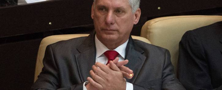 Cuba's new president Miguel Diaz-Canel, applauds during the speech of Cuban former president Raul Castro (out of frame) after he was formally named president by the National Assembly, in Havana on 19 April 2018. Picture: AFP