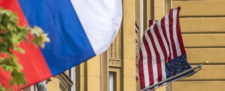 FILE: A Russian flag flies next to the US embassy building in Moscow on 31 July, 2017. President Vladimir Putin on 30 July 2017. Picture: AFP.