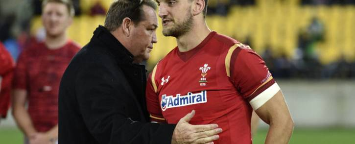New Zealand head coach Steve Hansen (L) talks with Wales captain Sam Warburton (R) after the rugby Test match between the New Zealand All Blacks and Wales in Wellington on June 18, 2016.  Picture: AFP