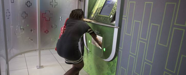 A patient collects her chronic medication from a pharmacy dispensing unit in Alex which works like an ATM. Picture: Ihsaan Haffejee/EWN