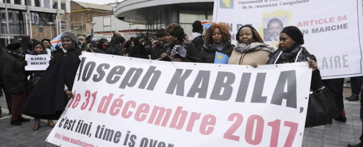 FILE: Members of Congolese associations calling Joseph Kabila to step down as President of the Democratic Republic of Congo, take part in a demonstration on 30 December 2017 in Brussels. Picture: AFP.
