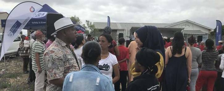 FILE: Western Cape Community Safety MEC Dan Plato speaks to residents in Manenberg during a campaign against women and child abuse on 2 December 2017. Picture: Monique Mortlock/EWN.