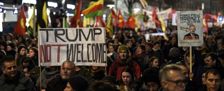 People protest against the attendance of US President Donald Trump at the upcoming Davos World Economic Forum, on 23 January, 2018, in central Zurich. Picture: AFP