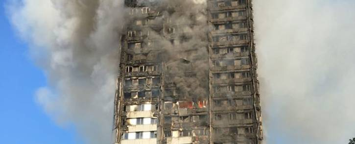 FILE: The Grenfell Tower apartment block smoulders in central London. Picture: @LondonFire/Twitter