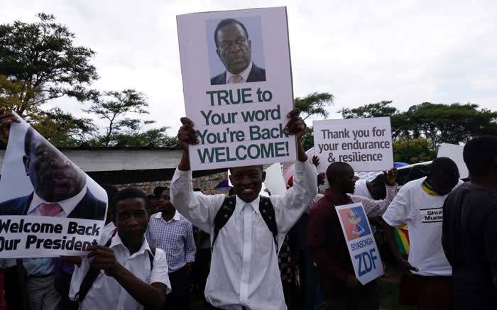 People gather outside Harare's airport to welcome former Zimbabwean vice-president Emmerson Mnangagwa on November 22, 2017 in Harare. Picture: AFP.
