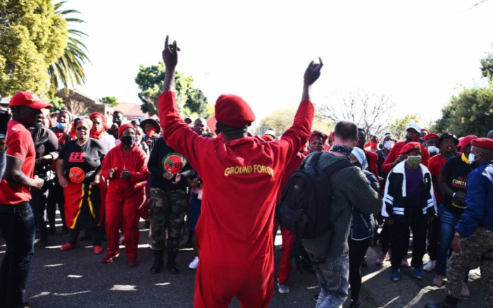 EFF members rally outside Uitsig High School as they wait for Malema