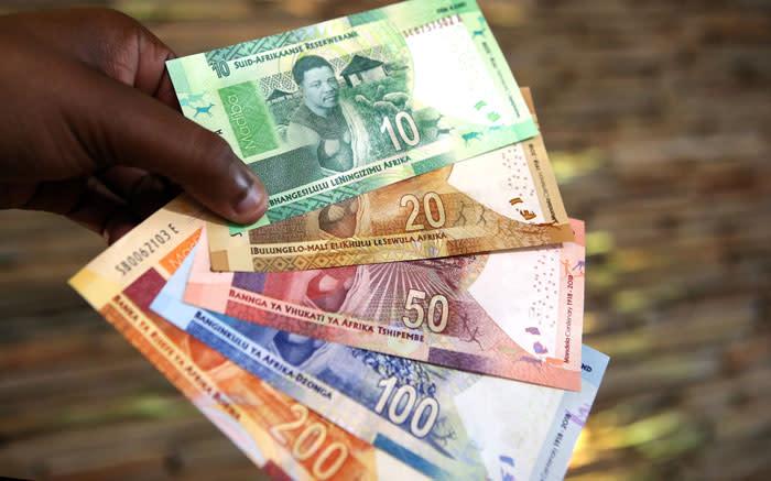 Rand flat as dollar rebound blocks surge to 14 mark