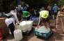 Cape Town residents stock up water reserves at the Newlands mountain spring during the city's water crisis. Picture: Bertram Malgas/EWN