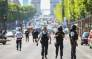 FILE: Police officers and anti-riot police officers patrol the Champs-Elysees Avenue on 19 June 2017 in Paris after a car crashed into a police van before bursting into flames. Picture: AFP.