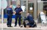 FILE: Police officers stand next to a person lying on the pavement in the Finnish city of Turku where several people were stabbed on August 18, 2017. Picture: AFP.