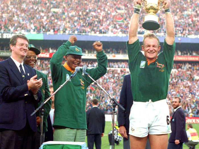 e9936ced8f1 ... by the iconic image of Captain Pienaar holding up the William Webb  Ellis Trophy with President Nelson Mandela, himself dressed in a Springbok  jersey.