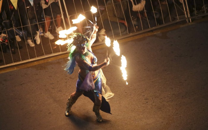 A dancer entertains crowds with her display of fire and lights.  Picture: Cindy Archillies/EWN