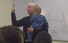 Photo of lecturer holding baby goes viral