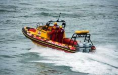 No sign of two students swept out to sea