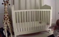 Dad saves his baby as he falls head first from his cot