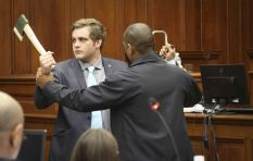 Van Breda demonstrates to the court how he scuffled with his family's attacker
