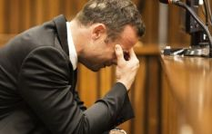 Oscar Pistorius stands in front of courtroom on his stumps to show vulnerability