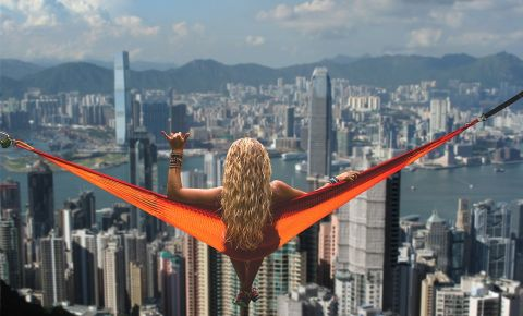 woman-in-hammock-overlooking-hong-kongjpg