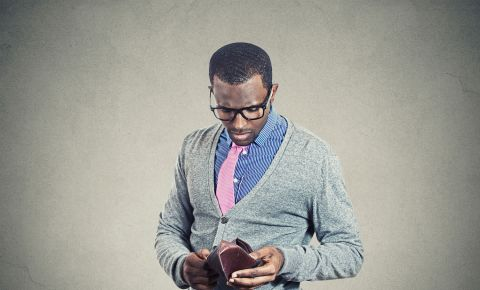 Broke young man empty wallet no money finances 123rfpersonalfinance 123rf
