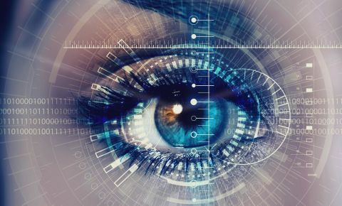 Future technology predictions (Close up of woman eye in process of scanning)