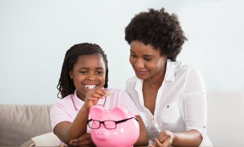 Mother teaches young daughter saving 123rfbusiness 123rfpersonalfinance 123rf