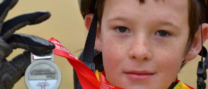 zach-hand-cyclist-medaljpg